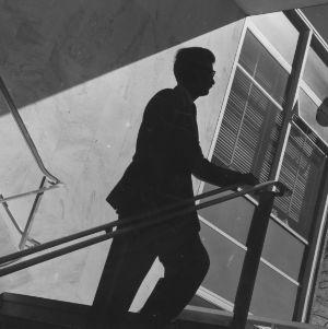 Henry L. Kamphoefner walking up stairs of Brooks Hall