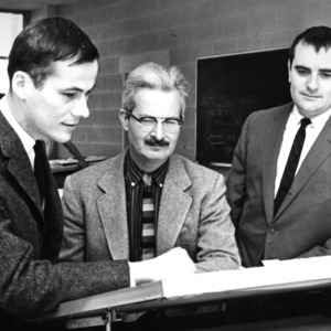 Dean Henry L. Kamphoefner and others at drafting table
