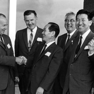 Dean Harry C. Kelly and others greeting Japanese visitors