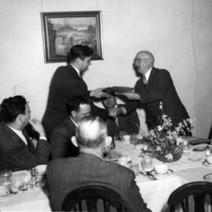 J. Harold Lampe giving award at dinner