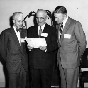 J. Harold Lampe and two others at event