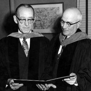 J. Harold Lampe and other in graduation robes