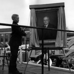 J. Harold Lampe's grandson unveils Lampe's portrait at opening of Engineers' Fair