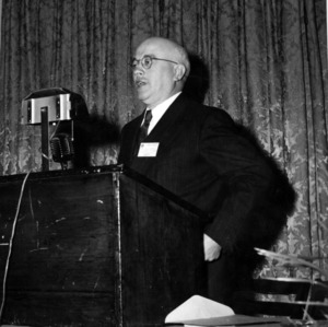 Dean J. Harold Lampe speaking at meeting for Association of General Contractors