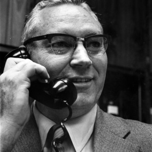 Dean James E. Legates on telephone