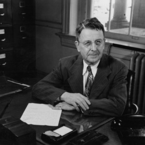 Zeno P. Metcalf at desk