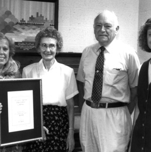 Donald E. Moreland with family and Libraries director Susan K. Nutter