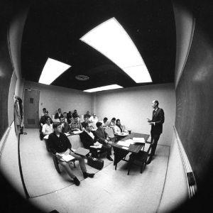 Raymond L. Murray teaching class