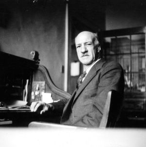 Dr. Thomas H. Nelson at desk
