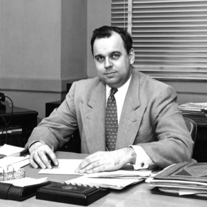 "William ""Bill"" A. Newell at desk"