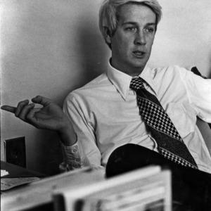 Dean John Poole at desk