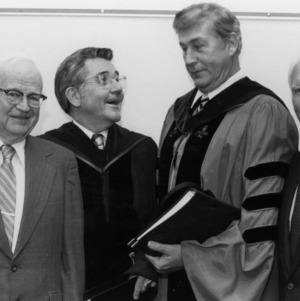 Chancellor Carey Bostian, UNC System President William Friday, Chancellor Bruce Poulton, and Chancellor John Caldwell at Poulton's installation