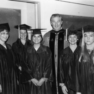Bruce R. Poulton with graduates at commencement ceremony