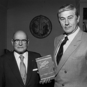 David A. Lockmiller and Chancellor Bruce Poulton, with Lockmiller's book, History of the North Carolina State College