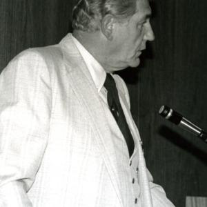 Bruce R. Poulton at podium
