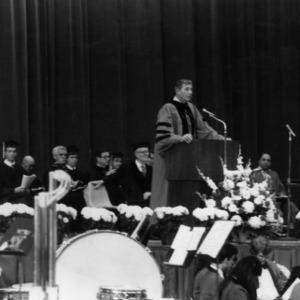 Bruce R. Poulton giving speech at graduation commencement