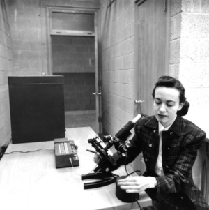 Frances Richardson with microscope
