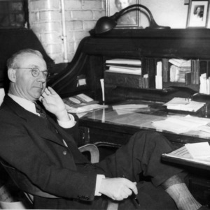 A. A. Riddle at desk