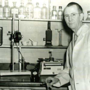 Professor G. Howard Satterfield in chemistry laboratory