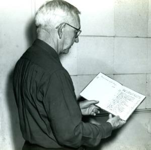 I. O. Schaub with book