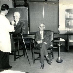 I. O. Schaub posing for portrait painting