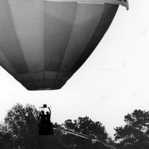 Governor Bob Scott getting balloon ride on NC State campus