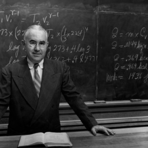 Physics professor Dr. Rufus H. Snyder teaching at blackboard