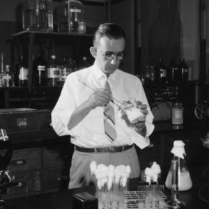 Dr. Marvin L. Speck in lab