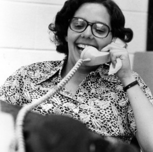 Student body president Mary Beth Spina on phone