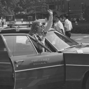 Cathy Sterling beside car