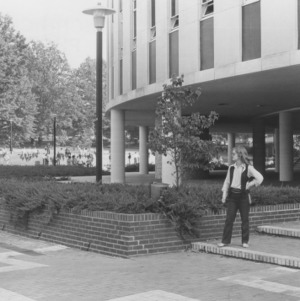Cathy Sterling in front of Harrelson Hall