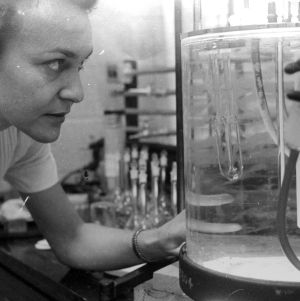 Woman with Chemistry Equipment in Laboratory
