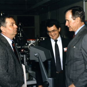 President George Bush with Jan Schetzina and Nino Masnari in Schetzina's lab
