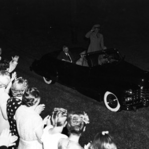 Dwight D. Eisenhower saluting crowd from car