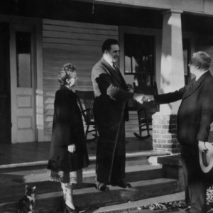 Clarence Poe shaking hands