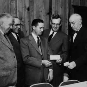 Clarence Poe handing over check
