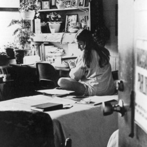 Girl using typewriter in dorm