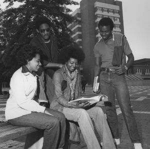 Four students on N. C. State's brickyard