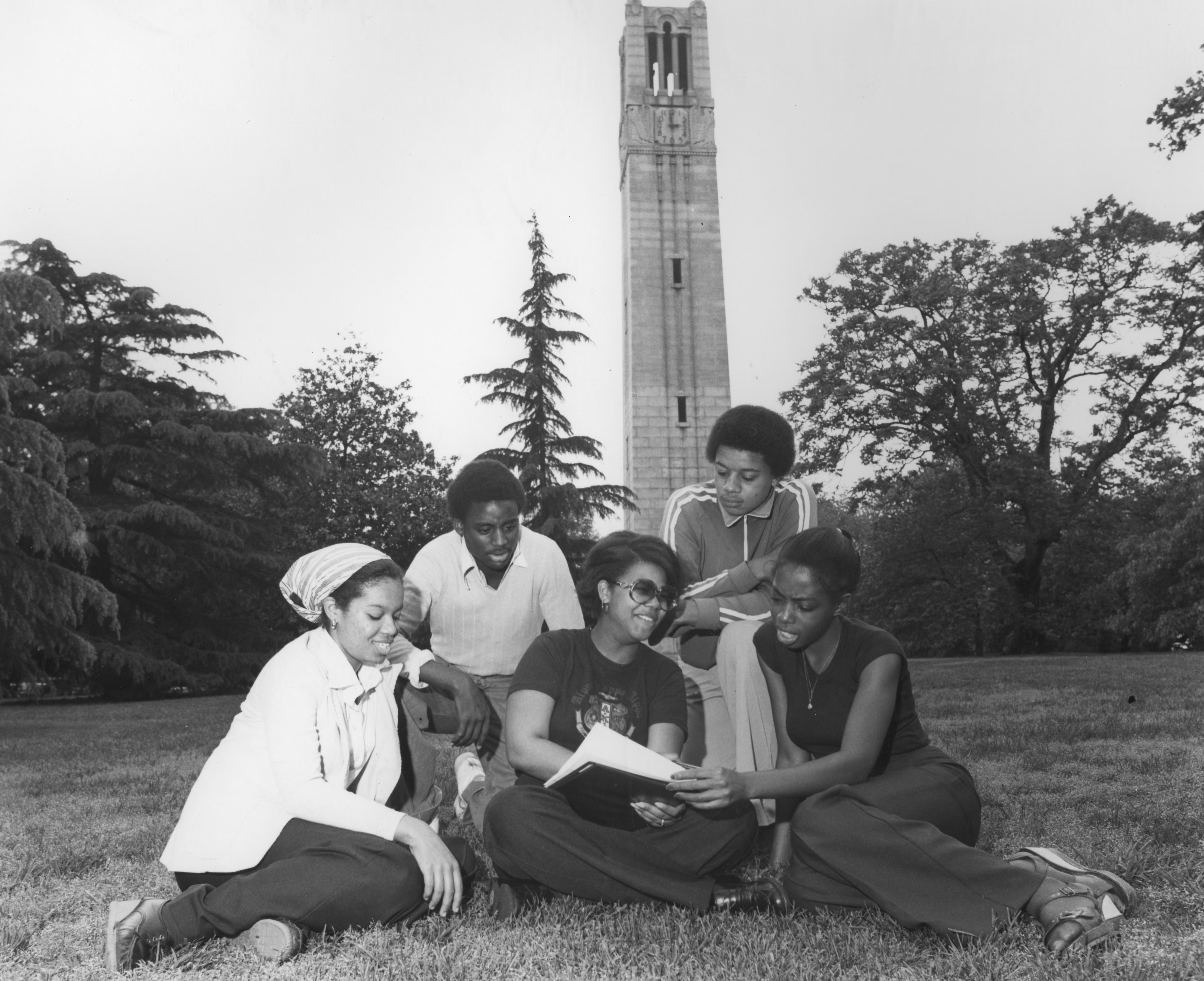 Five students in front of Memorial Bell Tower