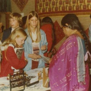 Shopping at booth at international fair