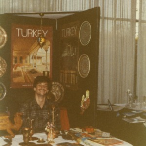 Man at Turkey booth at international affair