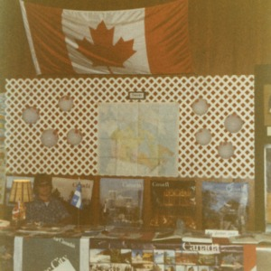 Man at Canada booth at international fair