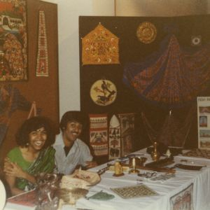 Two people at India booth at international fair