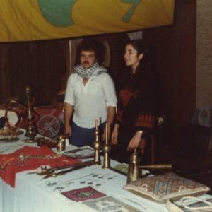 People at booth at international fair