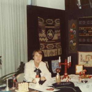 Woman at Norway booth at international fair