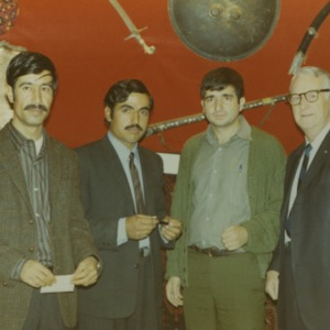 Four men at international fair