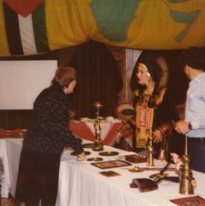 People at Arab World booth at international fair