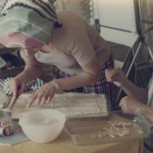 Two international students preparing dish