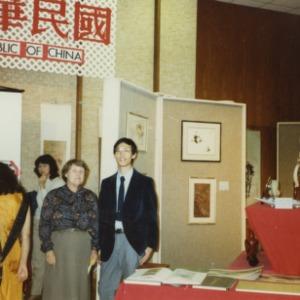People at China booth at international fair