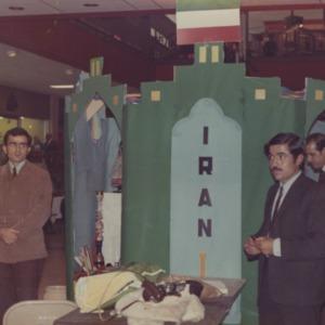 People at Iran booth at international fair